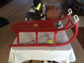 Old red sled to be placed under tree
