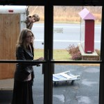 Leesha - the door opener for the day - singing while she works...note Ben's expression. (SST)