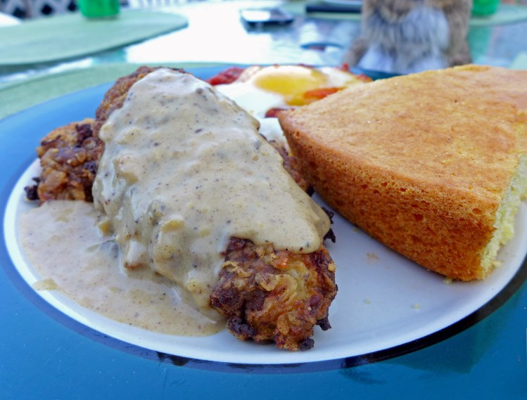 Chicken fried steak and gravy with skillet cornbread and chili shakshuka.