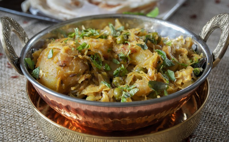 Cabbage with potatoes and green peas (Bandhakophir Torkari)
