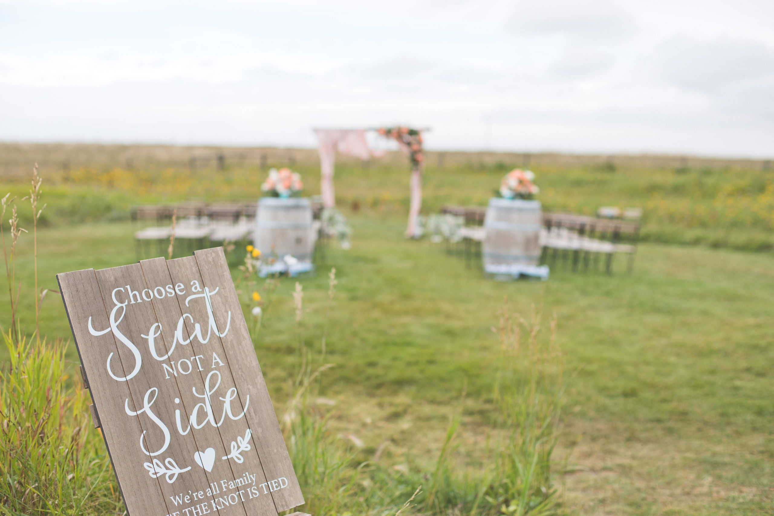 """Wood wedding sign that says """"choose a seat not a side"""" We're all family once the knot is tied. Outdoor weddings in southern Alberta. The Gathered"""