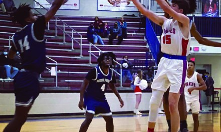 Pass Christian Basketball splits with Moss Point