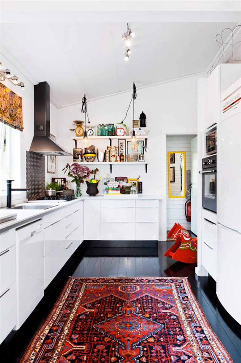 red persian rug in a kitchen on a black floor