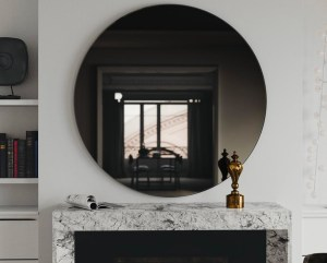 smoked glass mirror above fireplace