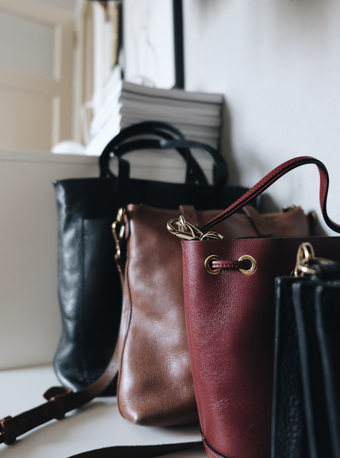 small space closet organization: leather bags