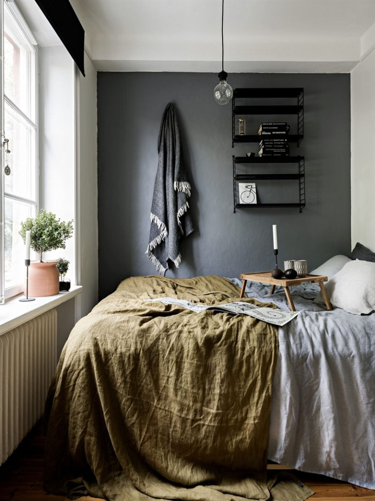 small bedroom with one dark wall