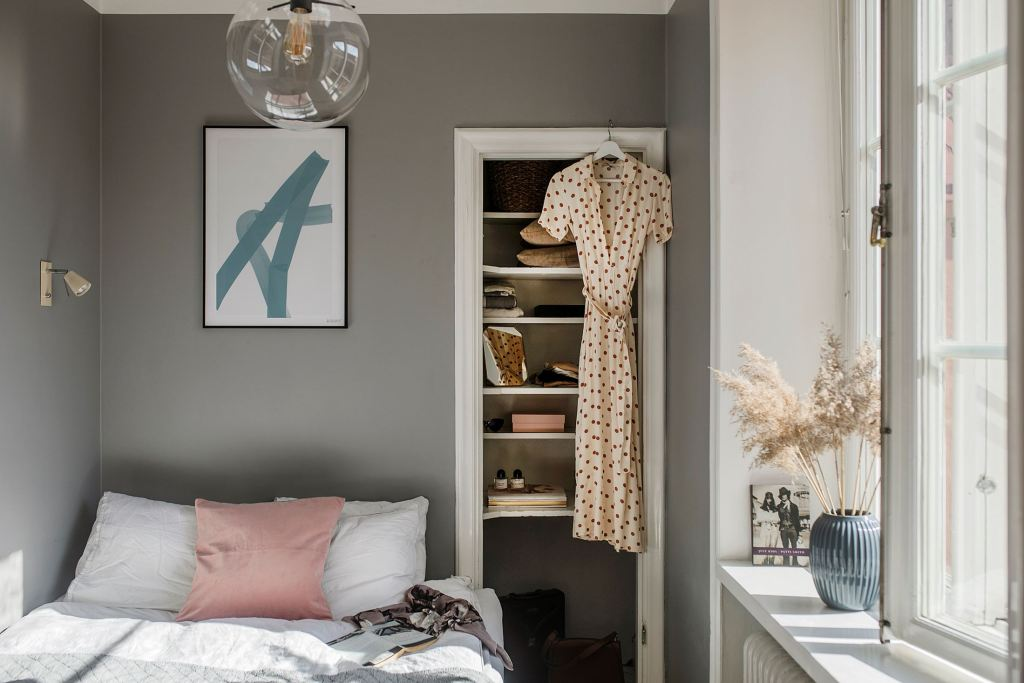 small bedroom with open closet