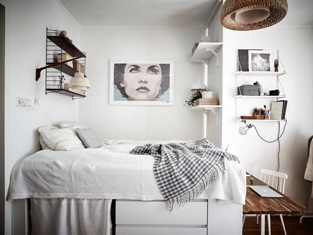 small bedroom with raised bed