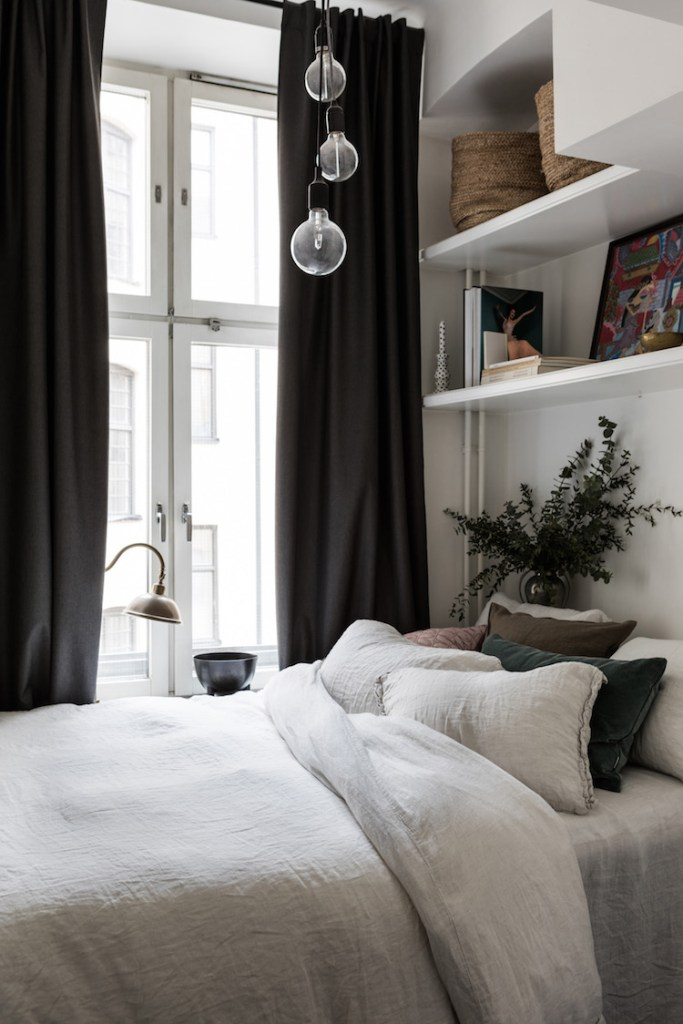 small bedroom with shelves