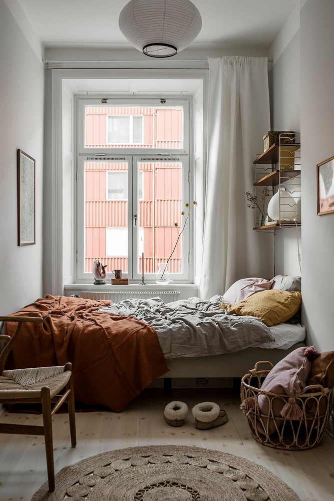 small bedroom with wall to wall curtains