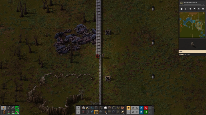 Factorio screenshot with walls, turrets, and biter corpses - Wube Software, environmentalism, ecocriticism, ecology