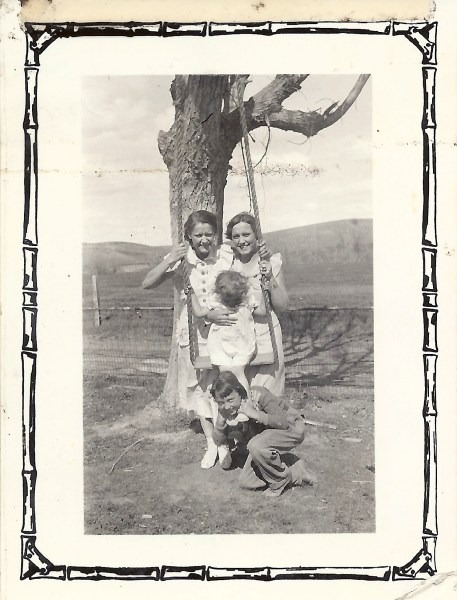 This photo was labeled by Estelle, 'June 1935 at Grandma's'.  My grandmother identified the place as Montana and the people as Estelle on the left, Marj on the right, my Grandma is on the swing, Jackie is on the ground.