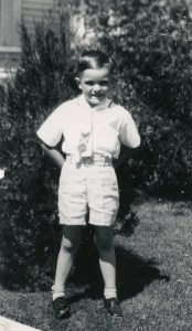 PETERSON, Ronald as young boy in front of house - smaller