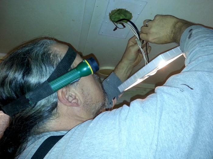 Paul wiring a light © Lori Byerly