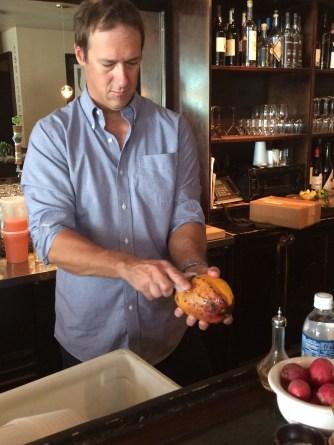 Ryan peeling a local mango