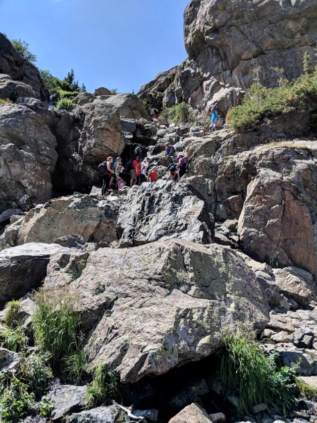 People hiking up mountain