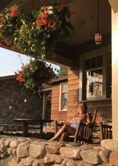 Girl sitting on porch in Black Hills