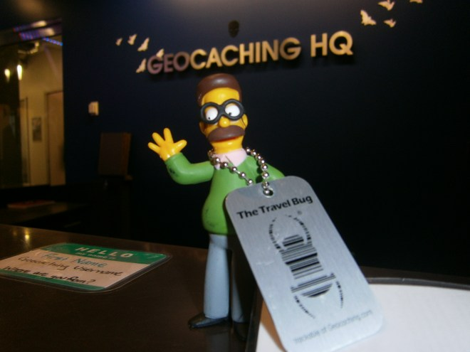 Ned Flanders with travel bug at Geocaching HQ