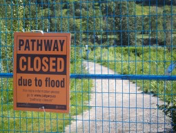 Long sections of the river pathway system in Calgary are still closed due to flood damage. Crews are hard at work on repairs.