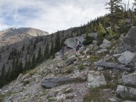 Mrs. GeoK and K just up the trail from the boulder field. Our goal is on the ridge below the false summit.