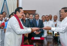Sri Lanka's former President Rajapaksa is sworn in as the Prime Minister before President Sirisena in Colombo