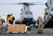 Marines load humanitarian supplies onto CH-46E helicopters in support of Operation Tomodachi
