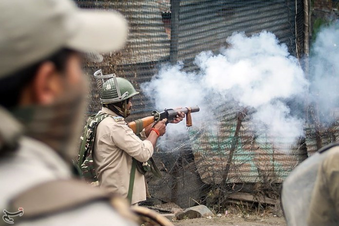 Police Protesters Clash after Eid Prayers in Kashmir