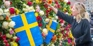 Woman offering tribute to terrorist victims in Stockholm