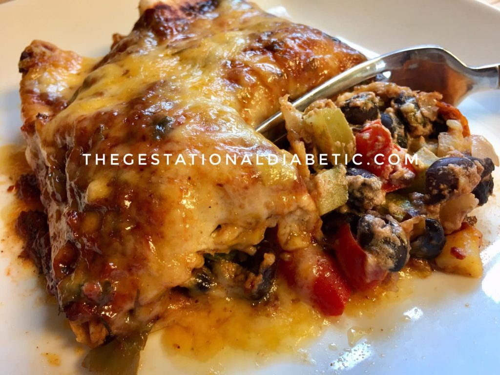 2 enchiladas stuffed with beans and veggies