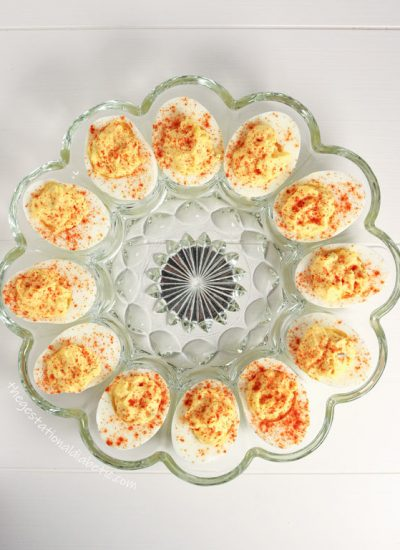 Overhead shot of deviled eggs in a circle glass platter