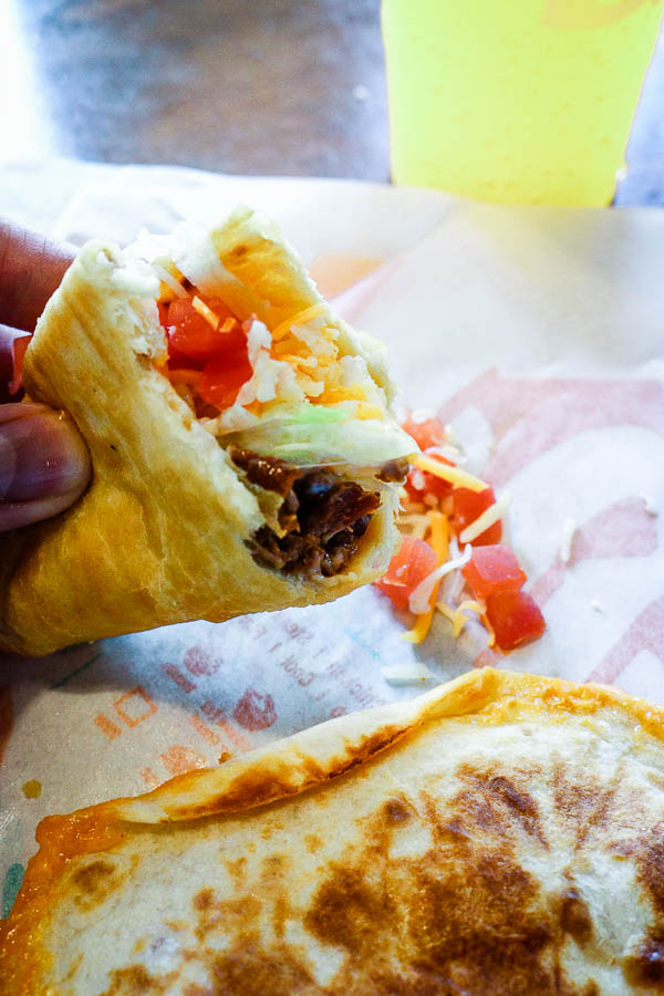 Taco Bell chalupa being eaten