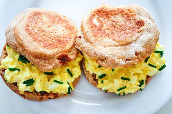two egg salad sandwiches on English muffins