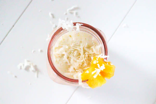 Healthy Pina Colada Chia Pudding in glass jar blended as a smoothie overhead look