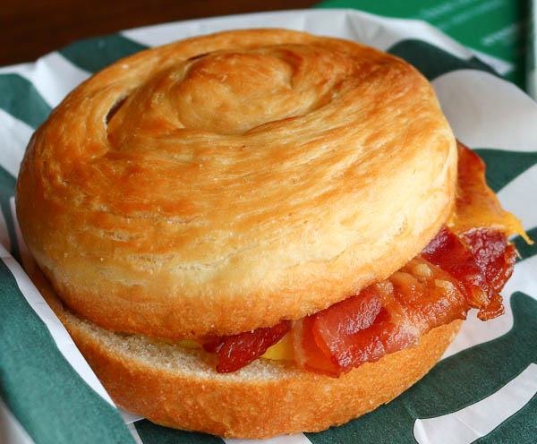 Starbucks breakfast sandwich with bacon and cheddar cheese