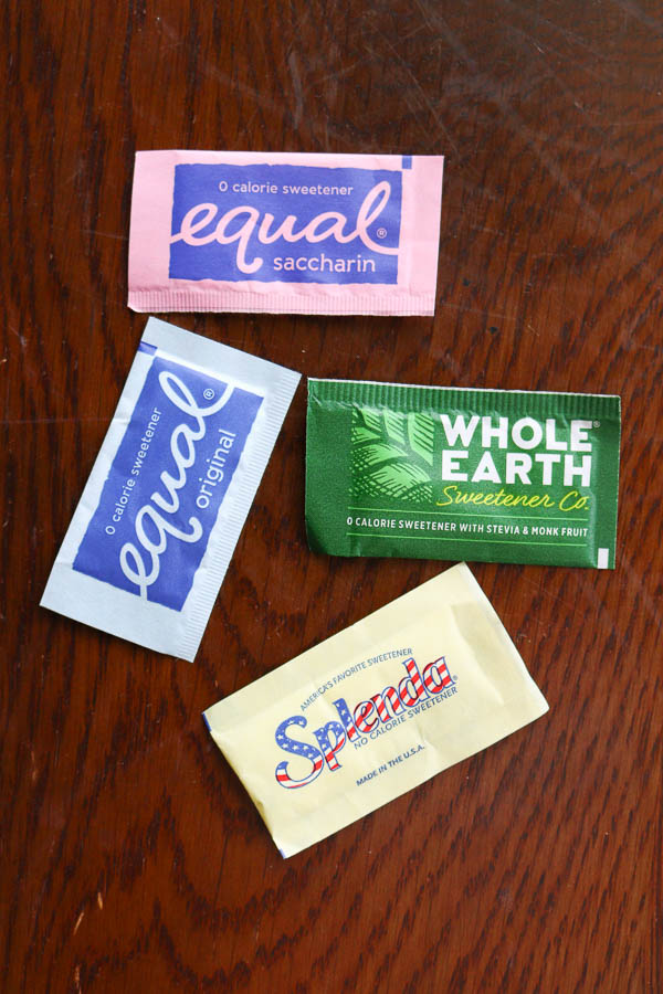 4 different sweetener packets from at starbucks