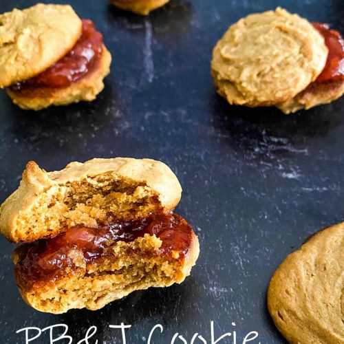 peanut-butter-and-jelly-cookie-sandwich-with-a-bite-taken-out