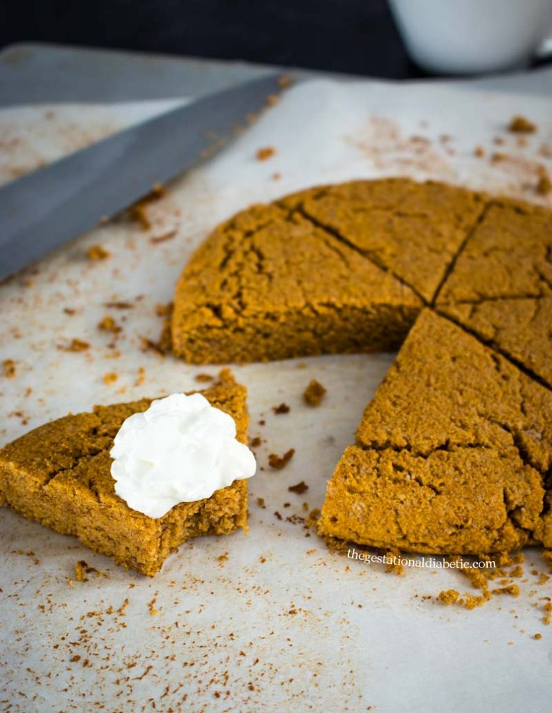 pumpkin scone bitten into with whipped cream