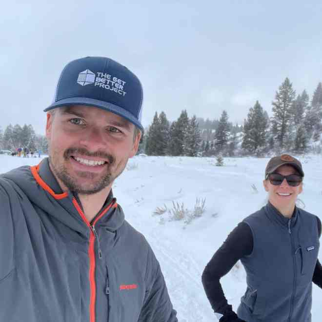 Joe and Emily Running in Steamboat with GBP hat on
