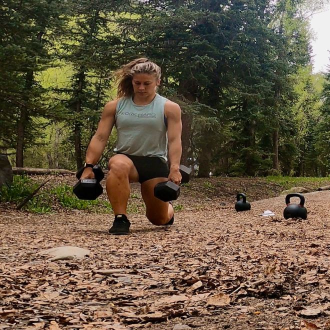 Emily doing lunges with WORK HARD tank on