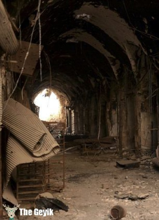 Damage and debris is seen in the souks of Old Aleppo