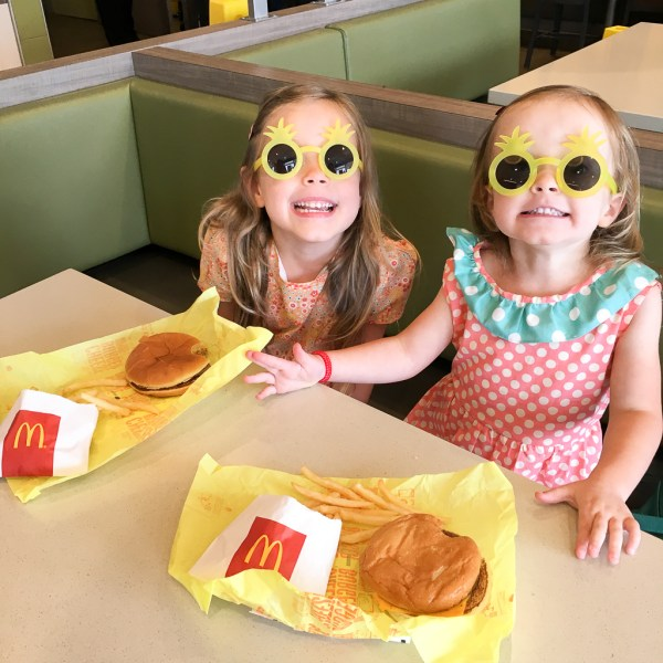 Two little girls eating Happy Meals at McDonald's - A Look Back at My Time as McDambassador - The Gifted Gabber