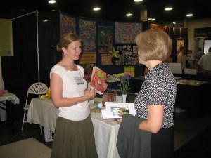 Heather talking to some lady about our book