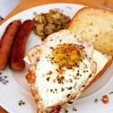 Breakfast - Fried Eggs with pork sausages, fried potatoes & garlic bread