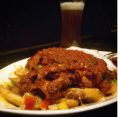 Grande fries - whole full plate of crispy french fries topped with baked pinto beans, Mexican cheese, jalapeño, peppers, guacamole , sour cream and chicken/ beef @ The Irish House , Mumbai