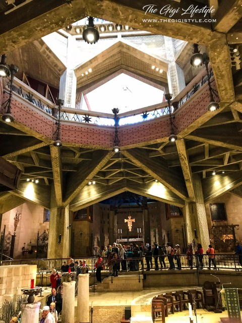 The first floor of the Basilica of the Annunciation. You can see the brightly-lit second floor above.