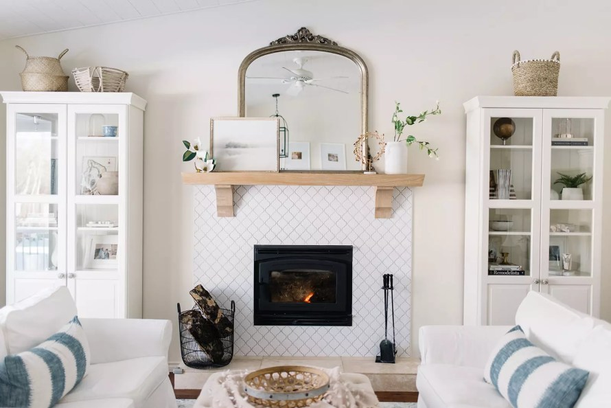 Winter Decorating Ideas - Keep it simple with chopped fire logs and a serene mantle vignette.
