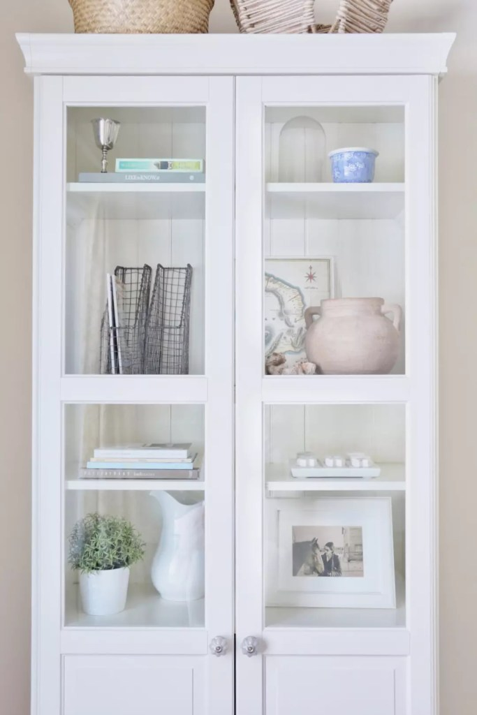 How to style a bookshelf - it can be tricky. Use a balance of large and small objects and add books stacked horizontally as well as vertically.