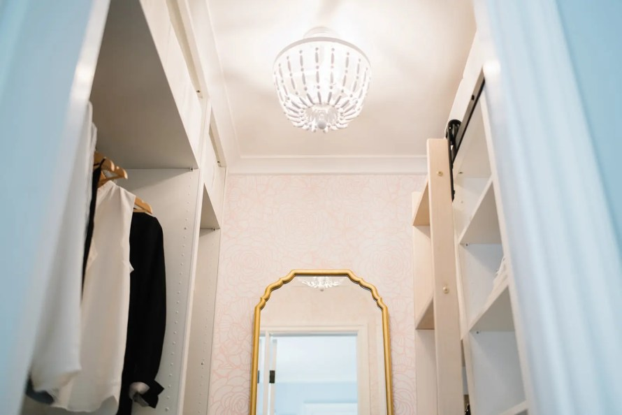 A statement semi flush mount beaded chandelier lights this custom closet