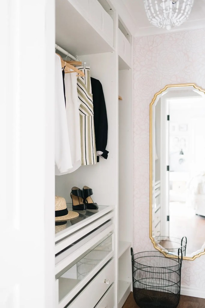 A small master closet gets a makeover with custom storage, wallpaper and a new chandelier