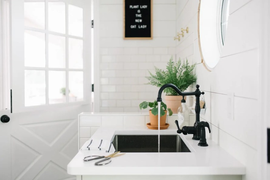 The mudroom sink is a great place to cut fresh flowers and greens make simple summer decor easy